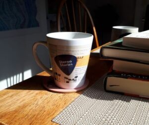 Coffee cup in sunshine and shade